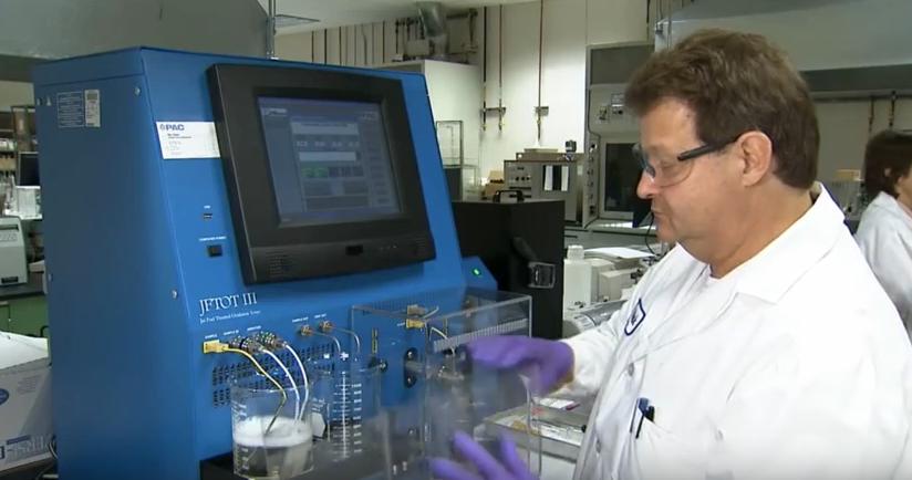 a Boeing researcher testing biofuels