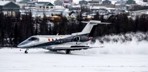 Pilatus Aircraft PC-24 on snow-covered gravel runway