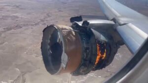 Boeing 777-200 with engine on fire